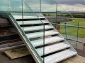 Galvanized escape stair with frameless glass balustrade at Boscombe Down Air Control Tower.