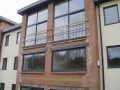Stainless steel Juliet Balconies with timber handrail, Admirals Quarter