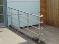 Brushed stainless handrail on side entrance with wheelchair access