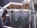Internal lobby staircase with glass treads...